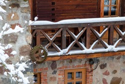 Farm in the forest in winter. Old houses and sheds by the lake. Old agricultural machinery