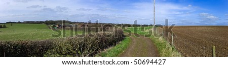 farm in the middle of farmland and fields