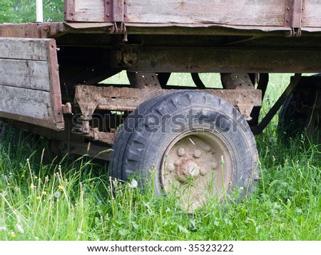 Farm land transportation old cart vehicle wheel - stock photo