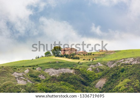 Farm on a field at a deep ravine