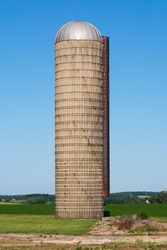 Farm silo in open field on a beautiful sunny morning.  Lee County, Illinois, USA
