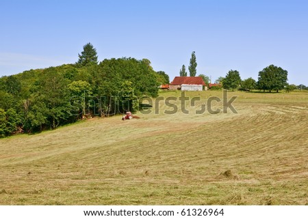 Farm tractor on hill