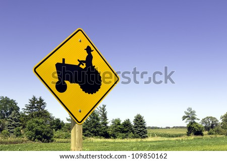 Farm tractor sign against blue sky