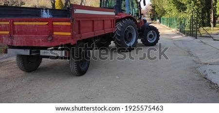 Farm tractor with a trailer Stok fotoğraf ©