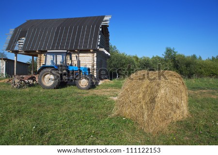 Farm with a tractor in the yard