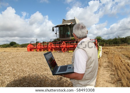 Farmer in field with harvester