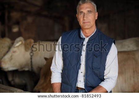 farmer in his cow farm