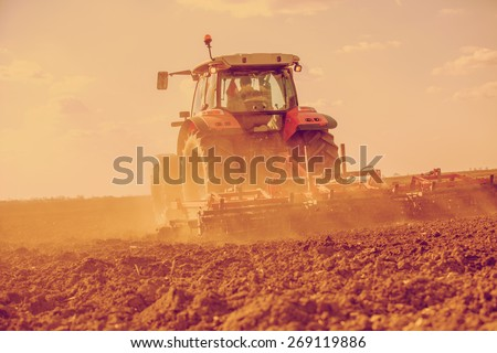 stock-photo-farmer-in-tractor-preparing-land-with-seedbed-cultivator-filtered-image-269119886.jpg