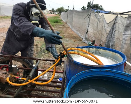 Farmer mixing the insecticide to spray ストックフォト ©