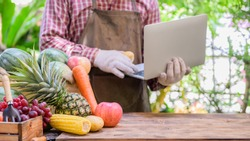 Farmer sell fresh fruit online. Online shopping and home delivery concept. New normal life and business after COVID-19. Lock down and Self-quarantine.