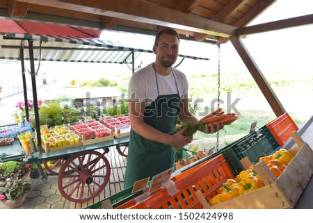 farmer sells fruit and vegetables from his own cultivation fresh from the field and from the greenhouse
