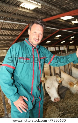 Farmer standing in barn