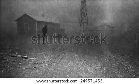 Farmer stands in a dust storm in New Mexico, Spring 1935. Photo by Dorothea Lange.