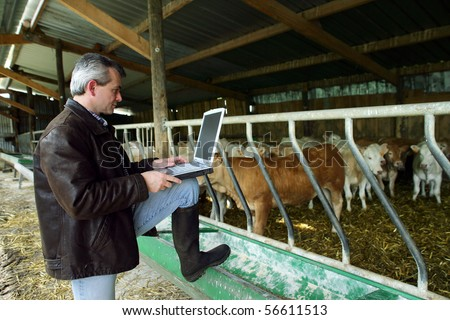 Farmer with a phone and a laptop computer #56611513