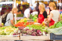Farmers' market stall with variety of organic vegetable.