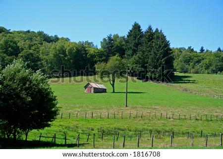 farmhouse in green field #1816708