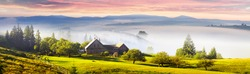 Farmhouse in the Carpathians, as the village in the Alps, Tatras, situated in a picturesque location on the river, where the warm morning rises fog, shrouding buildings, blooming field