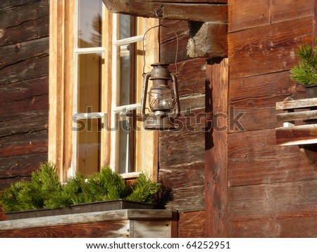 stock photo : Farmhouse with oil lamps as decoration