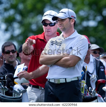 FARMINGDALE, NY - JUNE 17: Sergio Garcia and his caddy discuss the tee shot off the sixth hole at the Black course during the 2009 US Open on June 17, 2009 in Farmingdale, NY.