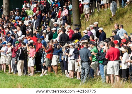 FARMINGDALE, , NY - JUNE 16: Spectators intensely watch and shoot images of Tiger Woods during a practice round at the 2009 US Open on June 16, 2009 in Farmingdale, NY.