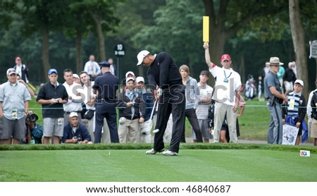 FARMINGDALE, NY - JUNE 16: Tiger Woods tees off the 12th hole on the Black Course during the 2009 US Open on June 16, 2009 in Farmingdale, NY.