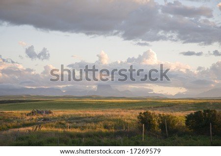 Farmland and buildings in the foothills of the rocky mountains in southern Alberta, Canada