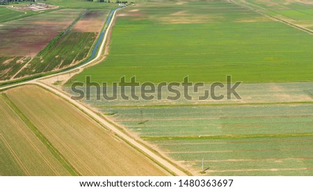 Farmlands with crops and agricultural machinery from above. Countryside with farmland. #1480363697