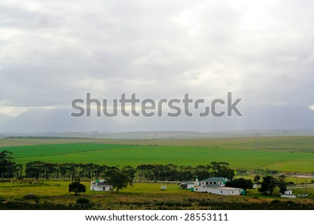 Farmlands with green pastures