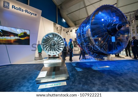 FARNBOROUGH, UK - JULY 12: Exhibition by Rolls-Royce of the latest Trent 1000 jet engine at the Farnborough Airshow, UK on July 12, 2012