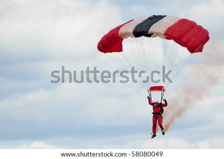 FARNBOROUGH, UK - JULY 24: Member of the British Army's Red Devils freefall parachute display team coming into land. July 24 2010, Farnborough Airshow, UK.