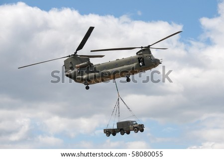 FARNBOROUGH, UK - JULY 24: RAF Chinook helicopter in vehicle lift demonstration. July 24 2010, Farnborough Airshow, UK