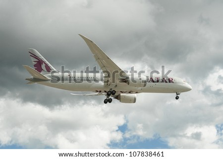 FARNBOROUGH, UK - JULY 11: The newly unveiled Boeing 787 Dreamliner in Qatar Airways livery on landing approach to the international airshow at Farnborough, UK on July 11, 2012