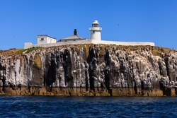 Farne Islands Lighthouse.  This lighthouse is situated on the Inner Farne Islands on the Northumberland Coast in Northern England.