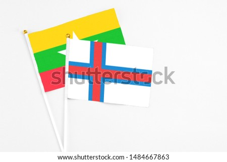 Faroe Islands and Myanmar stick flags on white background. High quality fabric, miniature national flag. Peaceful global concept.White floor for copy space. #1484667863
