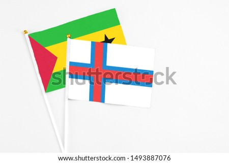 Faroe Islands and Sao Tome And Principe stick flags on white background. High quality fabric, miniature national flag. Peaceful global concept.White floor for copy space. #1493887076