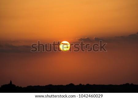 Fasano,Apulia/Italy - July 09 2017 : spectacular sunset in Selva di Fasano in Apulia region #1042460029