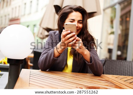 Fashinable girl in casual clothes doing selfie by smartphone.