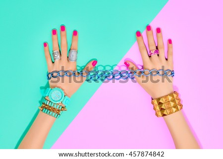 Fashion. Accessories fashion Set. Female hands Stylish Trendy Wrist Watches, Glamor bracelets and rings. Summer fashion girl Outfit, accessories. Hipster Party Essentials. Art Minimal fashion concept
