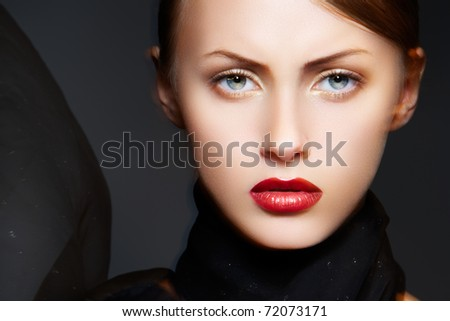 Fashion accessories. Model with chic red lips make-up. Real lights effect: mixed light with long exposure.
