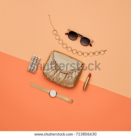 Fashion Accessories Set. Pastel Colors. Cosmetic Makeup. Glamor fashionable Woman Gold Handbag Clutch. Flat lay. Trendy Design fashion. Luxury Shiny Party lady. Creative Urban. Art. Minimal.
