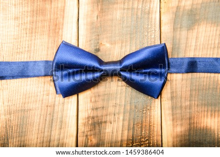 Fashion accessory. male bow tie on wood. Esthete detail. Modern formal style. vintage and retro style. Groom wedding. Wedding accessories. Elegant look. illusionist.