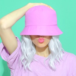 Fashion aesthetic girl in trendy summer accessories. Bucket hat. Street style. Urban. Vanilla Pastel colours