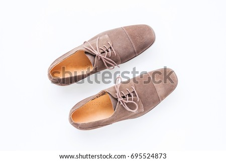 Fashion and beauty concept with men's accessories, brown classic shoes on white background #695524873
