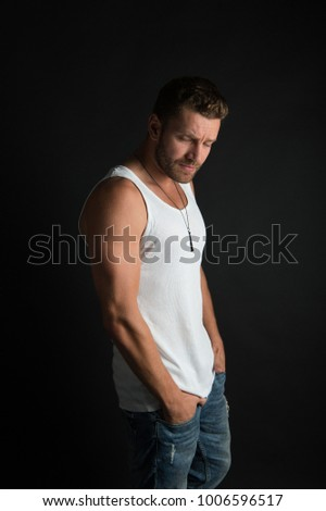Fashion and beauty. Fashion model on grey background. Handsome mucho guy in vest. Style and look, barber. Man with sad unshaven face in studio. #1006596517