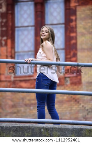 fashion and beauty. fashion model with long hair at building outdoor #1112952401