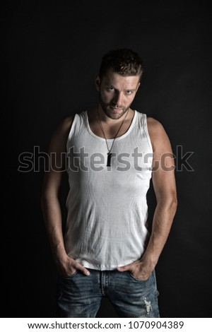 Shutterstock Fashion and beauty. Handsome mucho guy in vest. Style and look, barber. Fashion model on grey background. Man with unshaven face in studio.
