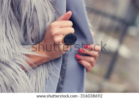 fashion and style girl holding her coat/manicured nails