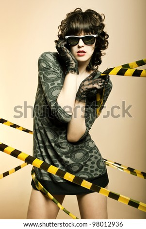 Fashion art portrait of a beautiful young sexy woman wearing sunglasses
