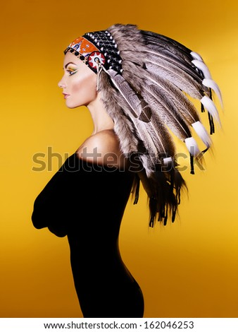 Fashion art portrait of a young lady in the Indian roach
