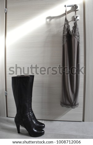fashion babydoll and boots on a sunlit door